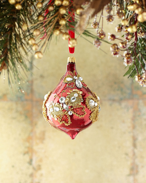 Give a beautiful embellished ornament its own stage: hang it from a chandelier, or suspend it from the frame of a small window. This burgundy finial beaded butterfly ornament from Neiman Marcus looks like it has been embroidered with gold beads. The glass ornament is 3.3 inches in diameter, 6 inches tall and is crafted in Poland.