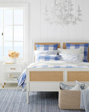 Gingham is a classic, and this duvet cover is refreshed in an up-scaled design, all the more appealing in French blue with white. The sheets and pillowcases play with a smaller scale. Even if you don't live on or near water, the ensemble lends a fresh, coastal vibe and plenty of inspiration for dreaming about that next beach-y experience. The Harbor Cane gingham duvet cover and shams are from Serena and Lily.