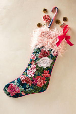 Embroidery plus a cuff of pink fluff give this Wildflower stocking from Anthropologie a boho vibe. It's 26 inches long, 11 inches wide and made of polyester.