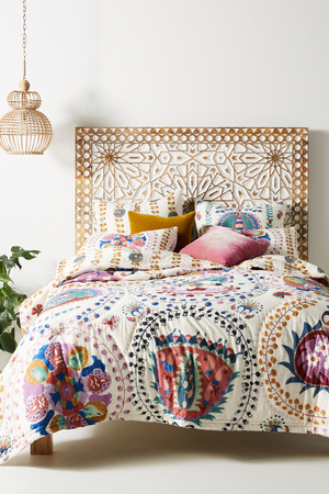 Change up your bedding with a casual Boho look. The Delissa quilt from Anthropologie shows off the age-old process of hand-screen and block printing, a craft practiced by artisans in Jaipur, India. Expert color masters lay down each screen frame, and there are 13 different by-hand processes on the lightweight cotton voile fabric, including the final by-hand kantha stitch.