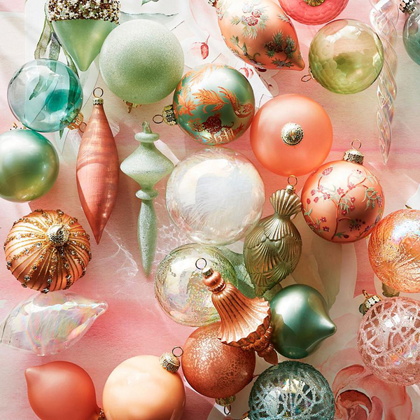 Pastel peaches and minty greens create one of Frontgate's curated 40-piece ornament collections called Royal Blush. The dreamy confections feature hand-painted chinoiserie designs in mouth-blown glass in opalescent and dew-kissed finishes, with applied gemstones, sequins and beading.