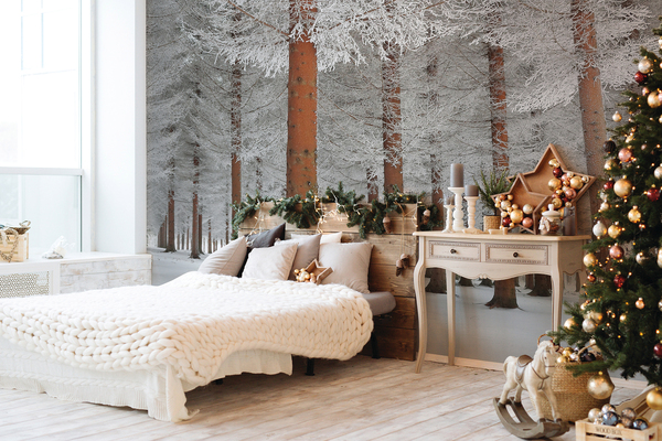 A snowy redwood forest transforms this bedroom, with peel-and-stick wallcovering from Wallsauce, and the Christmas decorations make it even more magical.