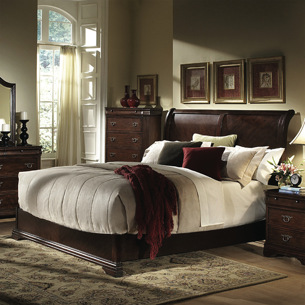 The bed is the centerpiece of every master bedroom. A traditional design aesthetic, such as this Hayneedle's York Low Profile Sleigh Bed Set (starts at $680) with a cherry wood finish, has timeless appeal and blends both feminine and masculine sensibilities.