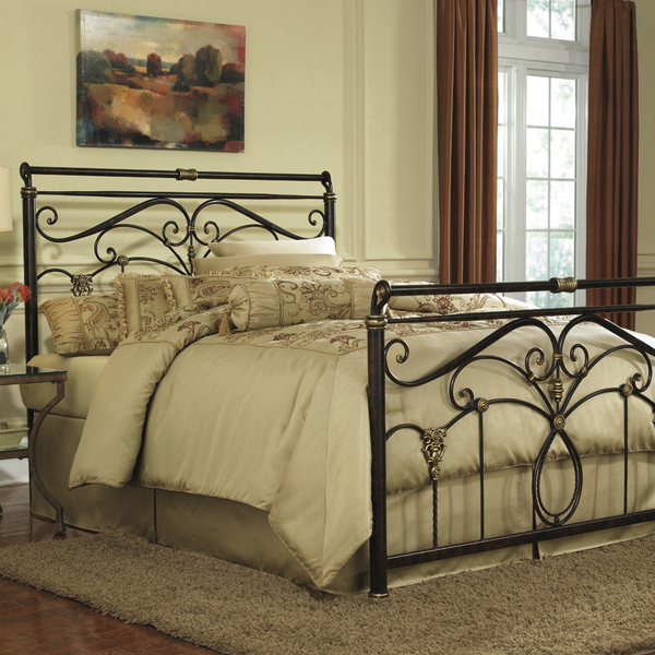 Bring a touch of romance into the bedroom with Hayneedle's Victorian-inspired Lucinda Sleigh Bed (starting at $279). Made of iron, this bed features scrollwork and castings finished in popular gold-finish accents.