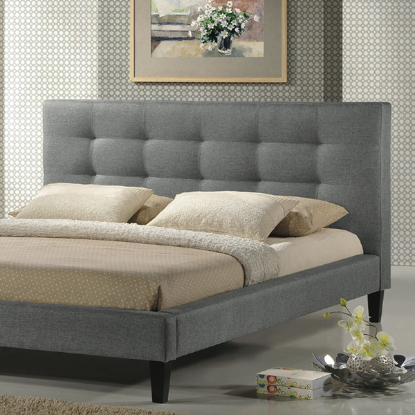 Mid-century style takes a modern turn in Hayneedle's Baxton Studio Quincy Linen Platform Bed (starts at $366). This platform bed is upholstered in sophisticated grey linen fabric and accented by a tufted headboard. This popular low profile frame stands on tapered legs and requires a mattress only.