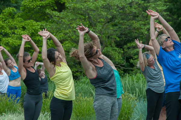 "Yoga students in this class at the Minnesota Landscape Arboretum seem to sway with the wind, just as the ornamental grasses do around them. Yoga outdoors ""is very relaxing,"" says Wendy Composto, a staff member at the Arboretum. ""You're in nature, with beautiful plants, and you can hear the birds."""