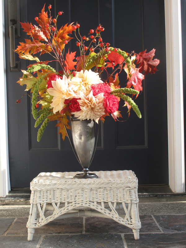 "In late-summer and fall bouquets, ornamental grains have an earthy sophistication. Debra Prinzing, author of ""Slow Flowers,"" used Highlander green millet seed heads and oak leaves in this lush bouquet, along with roses, dahlias and rose hips."