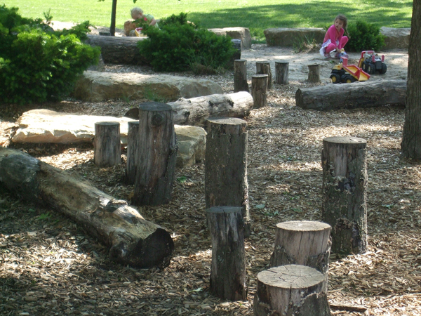 Stepping stones, tree stumps, logs and anything kids can climb on or hop over all help kids develop their confidence and poise.