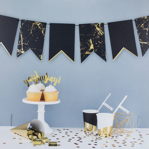 Black and gold paper banners are festive touches for welcoming in the new year.