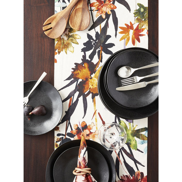 Black matte plates bring a modern edge to the table, especially when paired with a striking tropical flower watercolor runner called Suki. The cotton-linen blend comes in 90- or 120-inch length (14 inches wide); cloths and napkins also are available. The matte glaze accentuates the artisanal look of the Marin stoneware, which features organic curves and hand-antiquing on the rim.