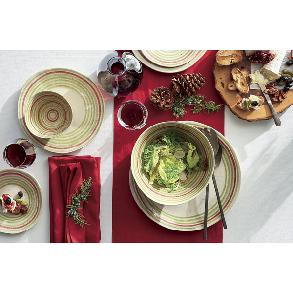 The simplest pattern -- concentric circles -- feels a little retro but also current in its olive-cast green, paired with a touch of red, which stands out against a red table runner. The not-so-perfect hand-drawn circles lend an artisanal look. Decorating the napkin is a sprig of blue spruce.