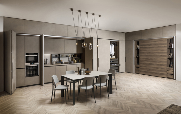 Hiding kitchens behind folding or pocket doors was a popular theme of EuroCucina. The idea: to make the kitchen more like living space, tucking away appliances when not in use. This Boxlife system, which includes closet modular, is from Scavolini.