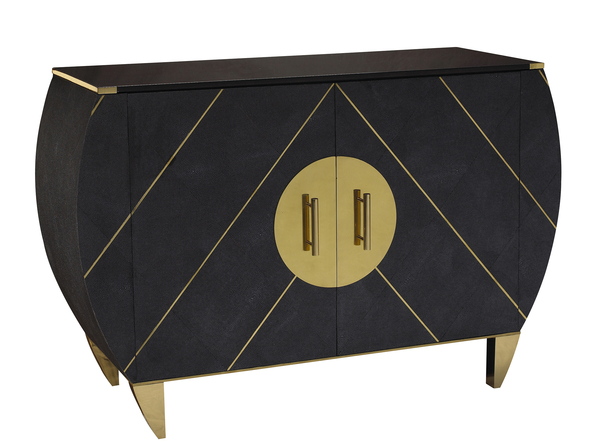 Art Deco style is enjoying a resurgence, with its curvy lines still modern and fresh. This Kir Royale chest from Facets, a collection by Michele Workman for French Heritage, features faux shagreen with brass inlay and bold circular hardware.