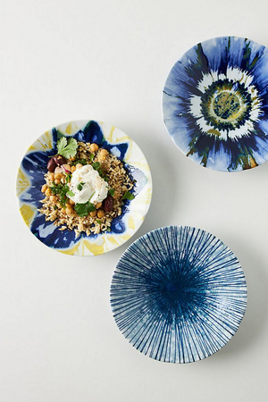 The glaze of these 9-inch porcelain plates from Anthropologie was inspired by shibori, a method of dyeing created by using wood blocks of various shapes, folding and pressing fabric. The plates, which are crafted in Japan, come in three patterns that will add an artful accent to your table. They are dishwasher and microwave safe.