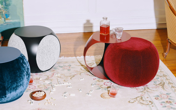 "Designers Tanja Hinder and Lauren Bugliarisi say that the whole is as great as the sum of its parts. So this piece, called a toof, is a curvy half-table, half-pouf in mohair velvet blend, overlaid with a powder-coated metal piece (matching or contrasting) that pulls out and morphs into a table. The brand is Marrimor (its tagline is ""objects for non-conformists""). The toofs stand 17 inches tall and are 24 inches in diameter."