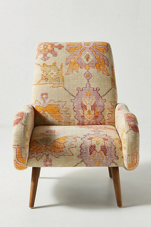 The upholstery of the Kennett chair from Anthropologie looks exactly like a kelim. The authentic overdyed look in maize actually is a digital print on cotton. The frame is tropical hardwood with oak wood canted legs that give it a modern look. The chair, which stands 37 inches tall, is 32 inches wide and a comfy 39 inches deep.