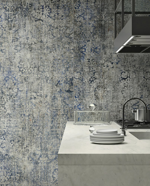 Some of the popular trends in rugs also are being translated into porcelain tile, such as this threadbare style from Del Conca called Timeline. It's for indoor/outdoor wall and floor, the largest is 48 by 104 inches, and the smallest 12 by 24 inches. Its weathered look, also reminiscent of aged fresco walls, suits industrial chic style. It comes in a mottled mix of three warm shades.