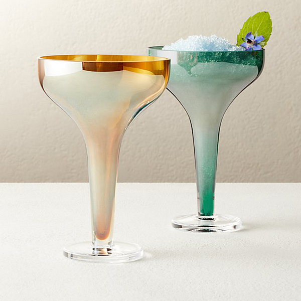 Channeling retro lusterware, these stemmed coupe cocktail glasses celebrate the past with a modern silhouette. The handblown soda lime glasses, available from CB2 in amber or green, are 3.5 inches in diameter and 5.25 inches tall.