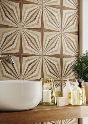 """Similar to traditional parquet, this oak wood-look ceramic called Dimore, from Emilceramica, creates optical-derived geometric motifs referencing a kaleidoscopic range of aesthetic inputs that reflect different """"stains"""" (eight different patterns) and variety of its veining effects. The 7 7/8-by-47 1/4-inch size, shown in Naturale, comes in three other shades."""