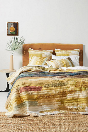 This quilted one-of-a-kind Vivie bedding from Anthropologie gives all the fall feels with its seasonal palette. The colors are hand-dyed, and the patterns digitally printed. The entire production is complex -- with age-old techniques of hand-screen and block printing that are a cultural cornerstone in Jaipur, India. The highly skilled artisans perform 13 different by-hand processes, up to the final appliques and kantha stitching. The quilts are available in twin, full, queen, king and California king size (the latter 92 by 108 inches).