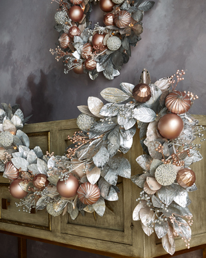 Blush and pewter shine in mixed pre-lit 72-inch garland from Horchow. It will lend a shimmery elegance to a mantel or doorway.