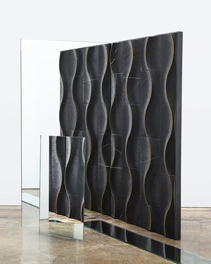 A swirling effect much like that of fabric is achieved in porcelain by New York City designer Alison Rose for Artistic Tile. It's a deconstruction of the lemniscate -- the symbol for infinity. The sleek, textured, dimensional stone won a Best of the Year award from Interior Design magazine in 2019. It mixes natural materials with artisanal details in a sumptuous modern way, with inlaid brass lines that curve gracefully through an intricate hand-carved ridge that flows across the surface and from one tile to the next.