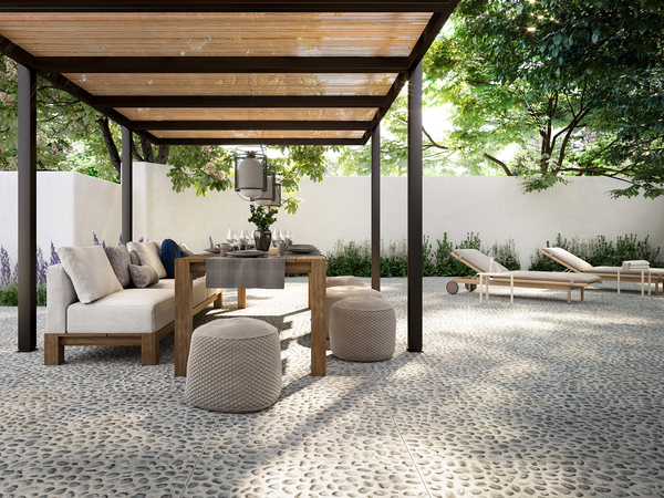 Like real pebbles, this dimensional porcelain tile from Refin creates a fabulous outdoor floor. The Risseu line was inspired by the Ligurian pebbles that decorate the floors of Genoese urban gardens and festivals. The three-dimensionality, already evident as a graphic effect, is further accentuated by slight structure that recreates the effect of the pebbles on the stoneware surface that come in just under 3-foot-square tiles that are about 3/4-inch thick.