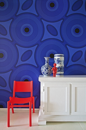 "An almost tone-on-tone pattern in a large-scale circular pattern that resembles Suzani was actually inspired by a common African print called ""shweshwe,"" seen in South African and Lesotho cultures from the 1800s. This contemporary revival is from Ghislaine Vinas for the New York-based Flavor Paper, which says, ""The enlarged design elements make it modern and the colorways will really make your walls pop."" It's shown in a vivid blue called Kingfisher."