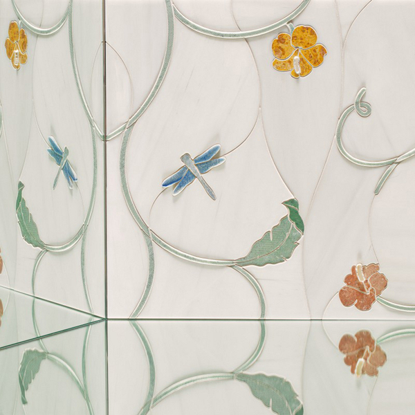Dimensional mosaics that also are upscaled are lending a stunning edge to a traditional form. Garden Party's dragonflies, butterflies and flowers pop against a milky white ground of Bianco Dolomiti with soft drifts of taupe veining. Subtle relief and varied textures are applied to multicolor marbles and onyx. This collection is from Artistic Tile.